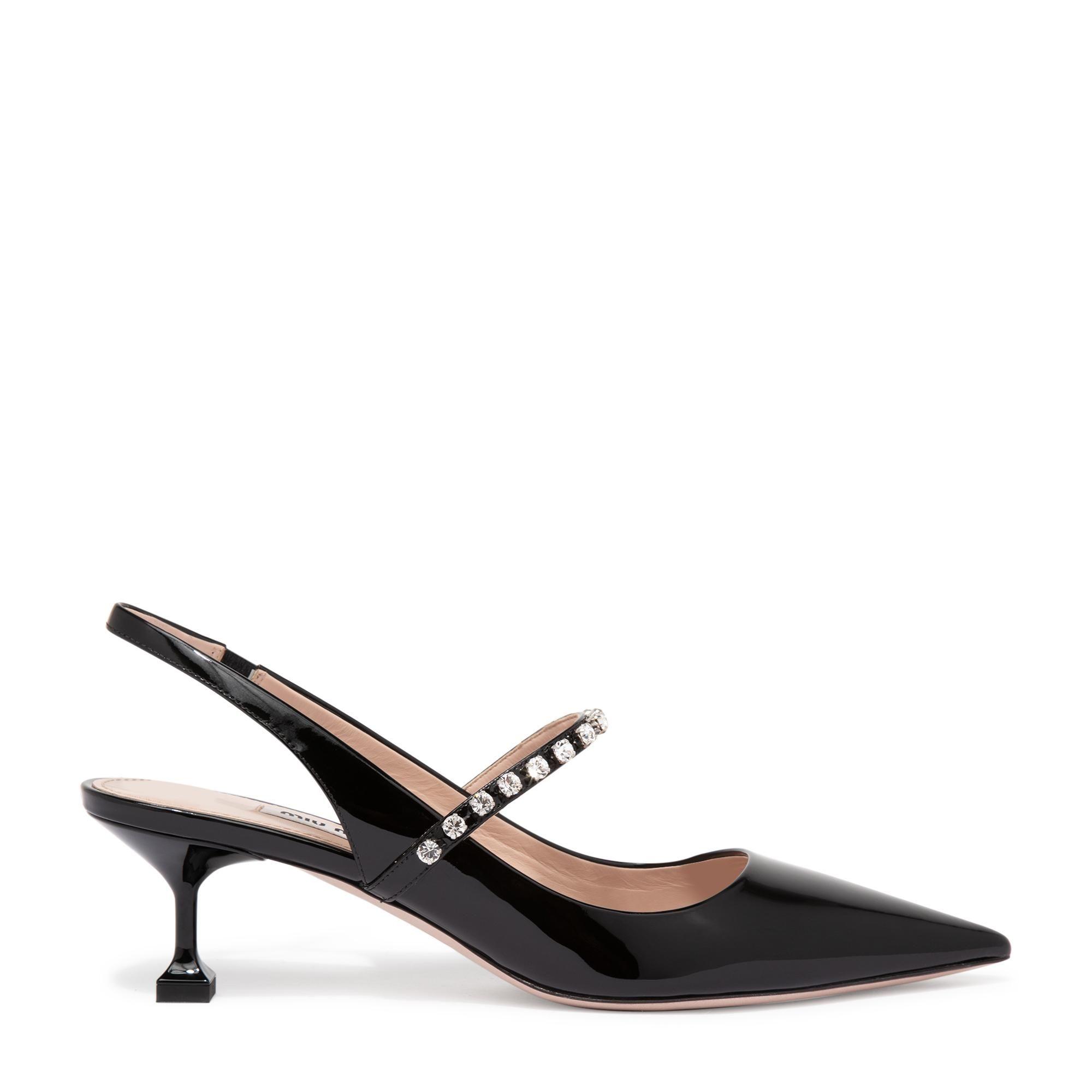 حذاء عالٍ من الجلد الصناعي اللمّاع