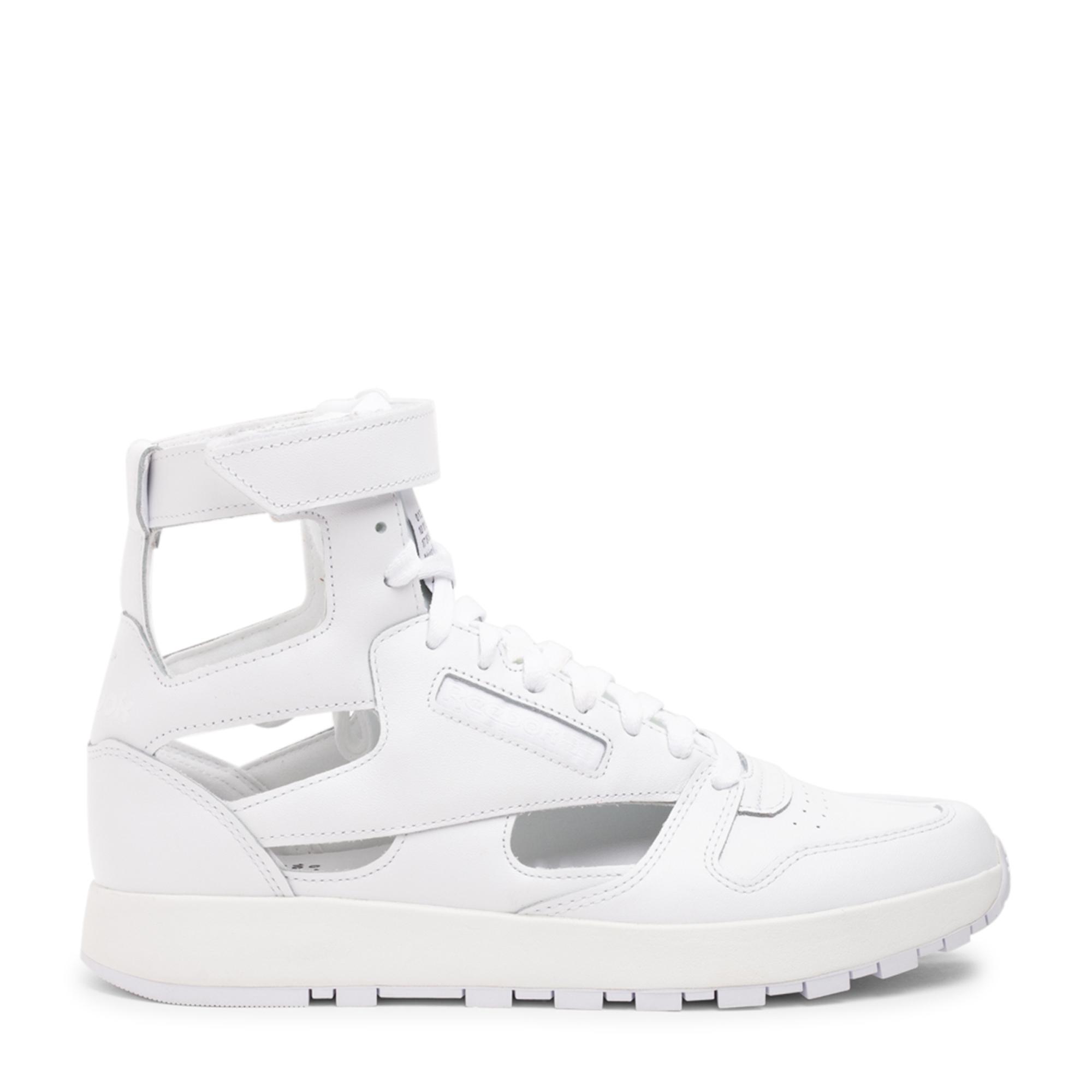 حذاء × ريبوك تابي الرياضي بطراز غلادياتور
